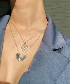 Ασημί κολιέ με κρεμαστό σύμβολιο ακτίνες ηλίου