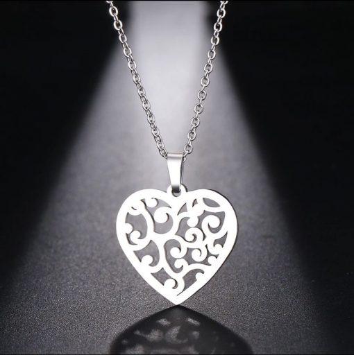 Χρυσό και ασημί κολιέ με κρεμαστό σύμβολο σκαλιστή καρδιά